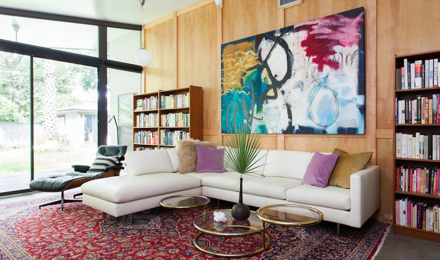 Neutral and classic furnishings like the Eames Lounge Chair are important in a room where color and artwork dominate.