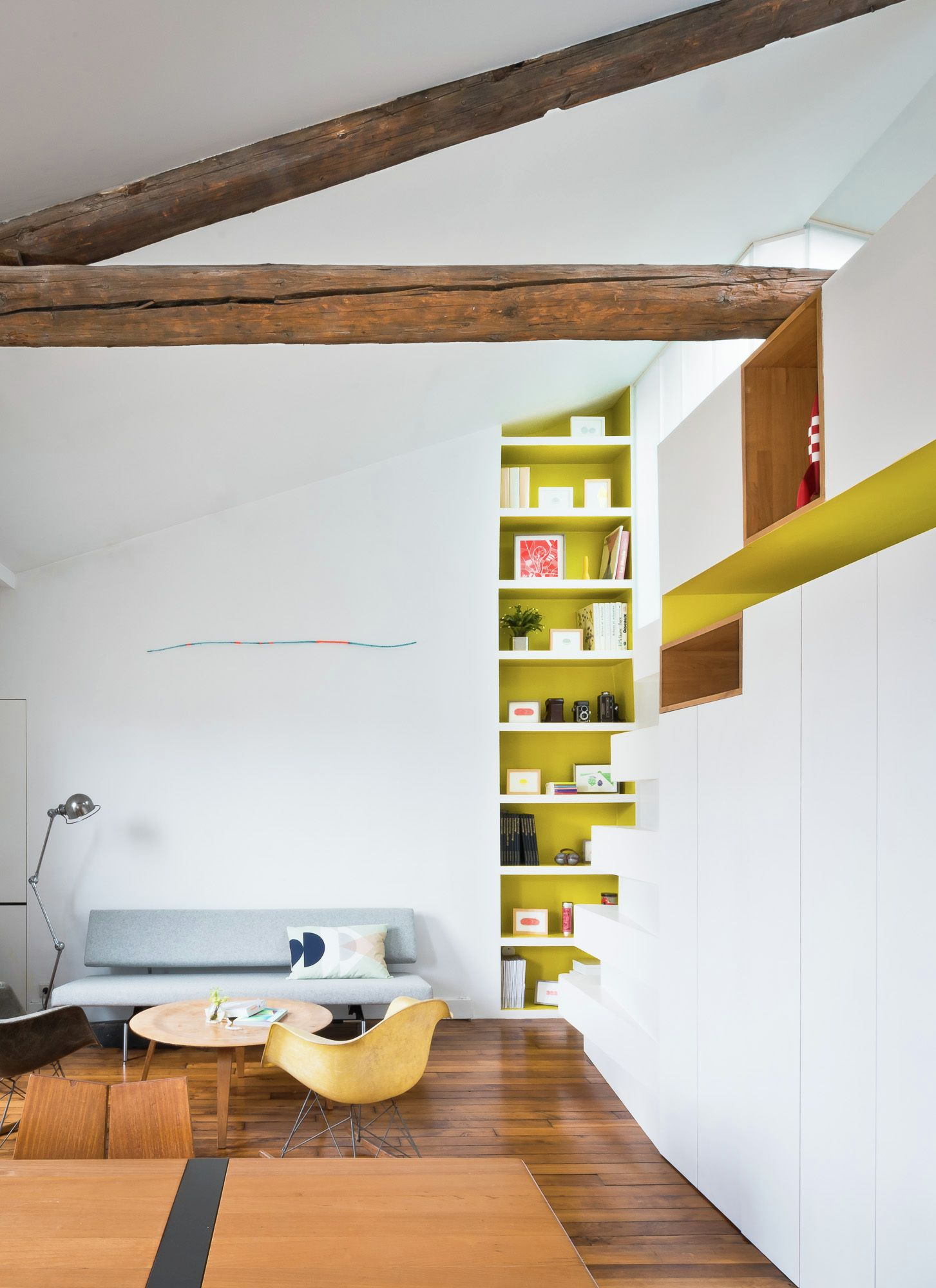 Redesigned Paris apartment living room corner shelves