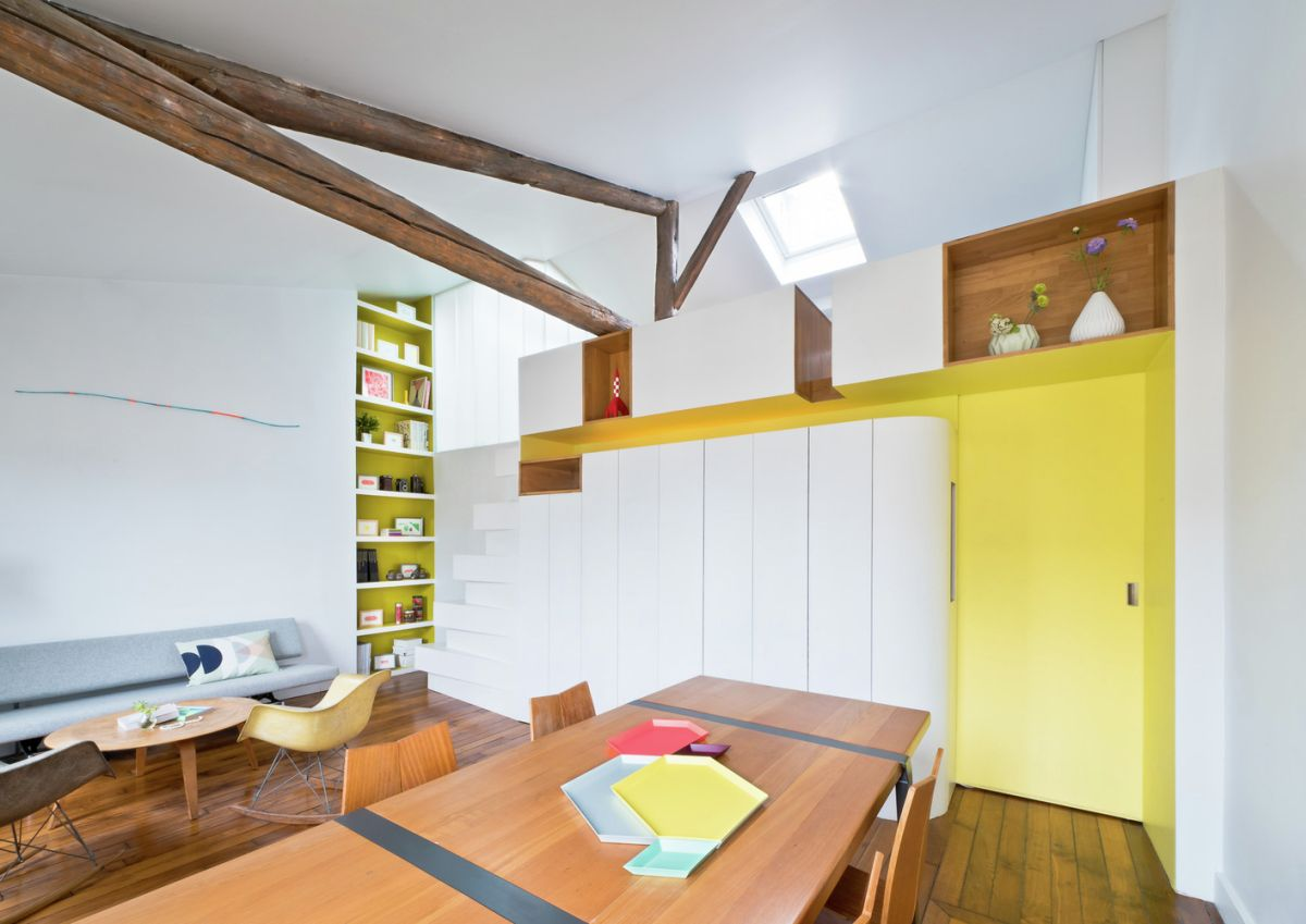 Redesigned Paris apartment social area yellow accents
