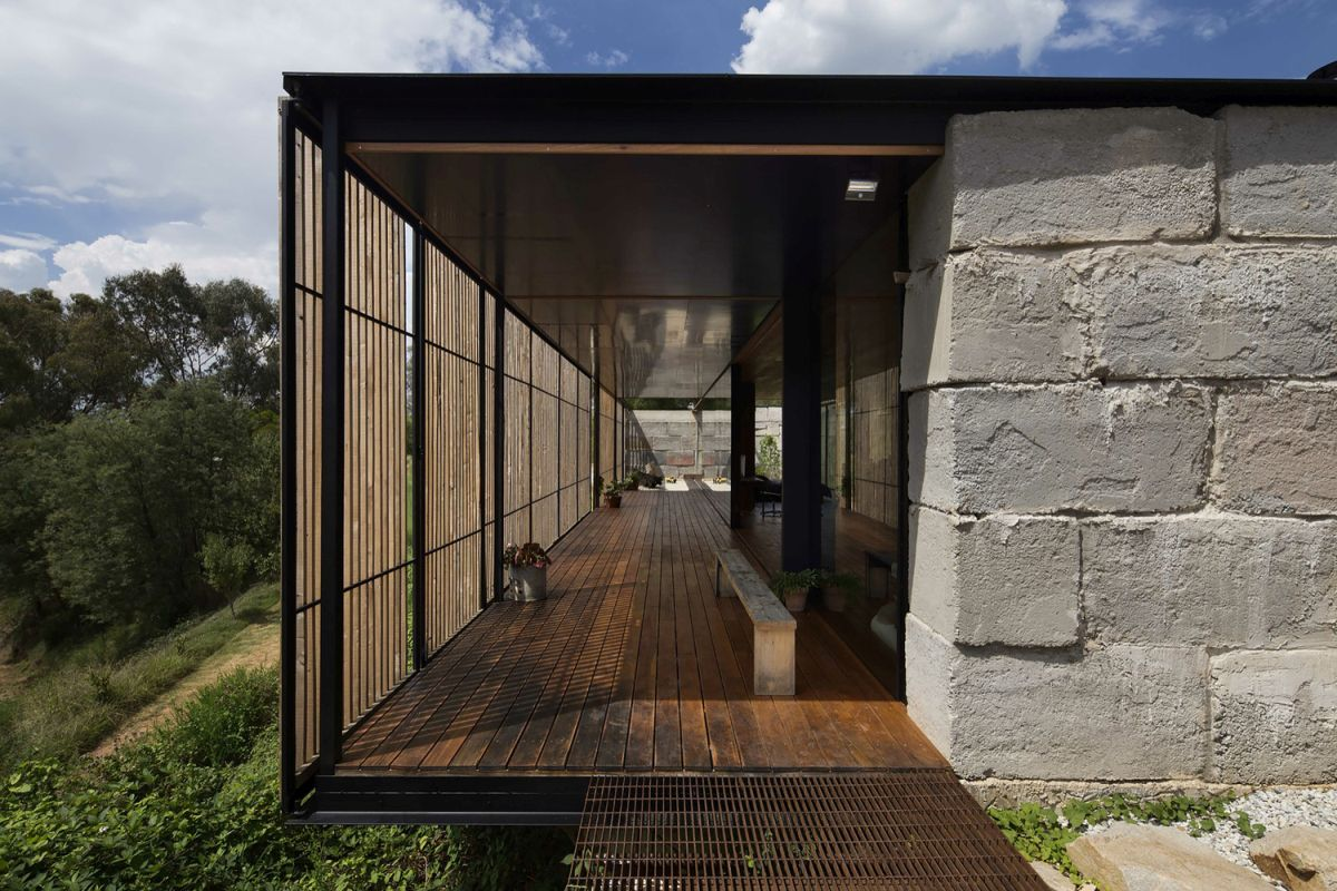 Innovative family home built of reclaimed concrete blocks for Concrete block construction homes
