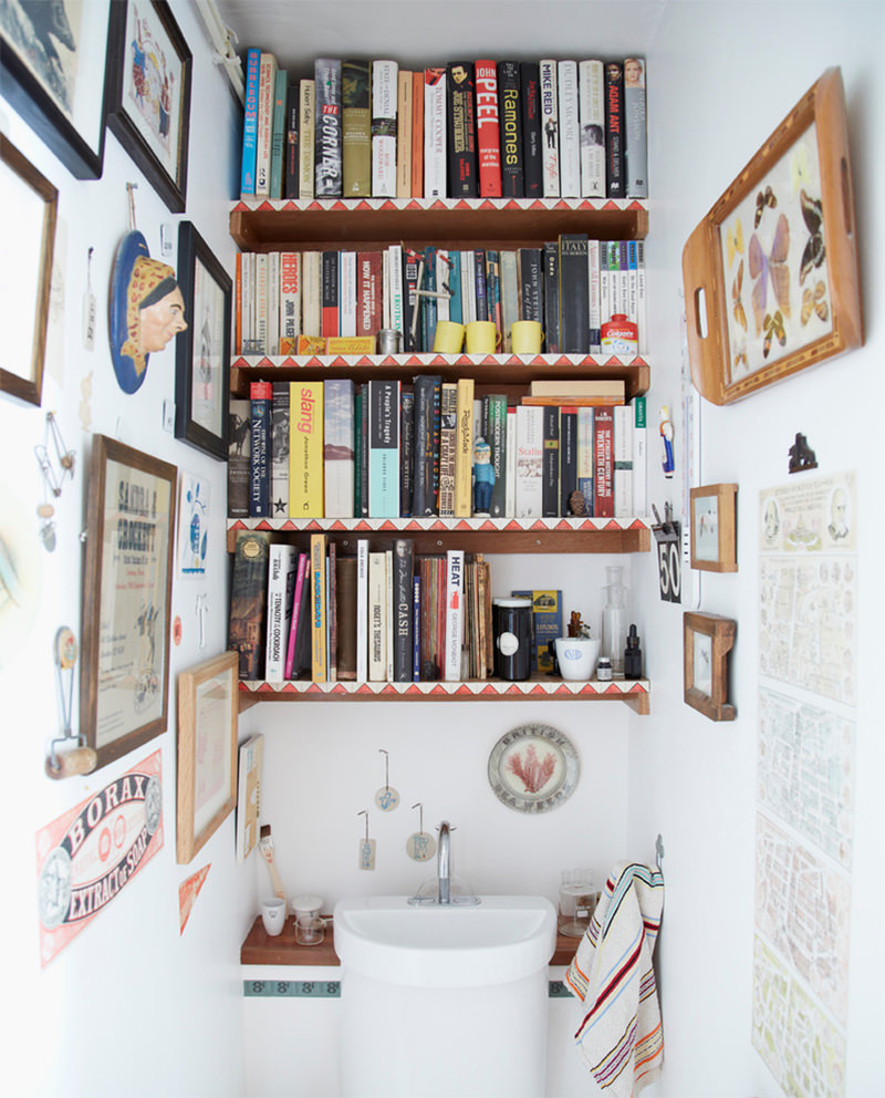 Small powder room decorated with books