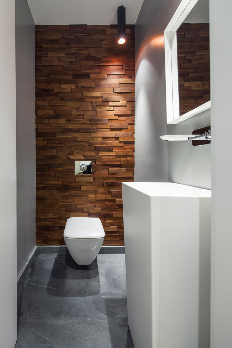 The B House small bathroom wood wall