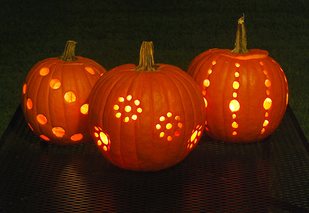 Use a drill to create a halloween pumpkin