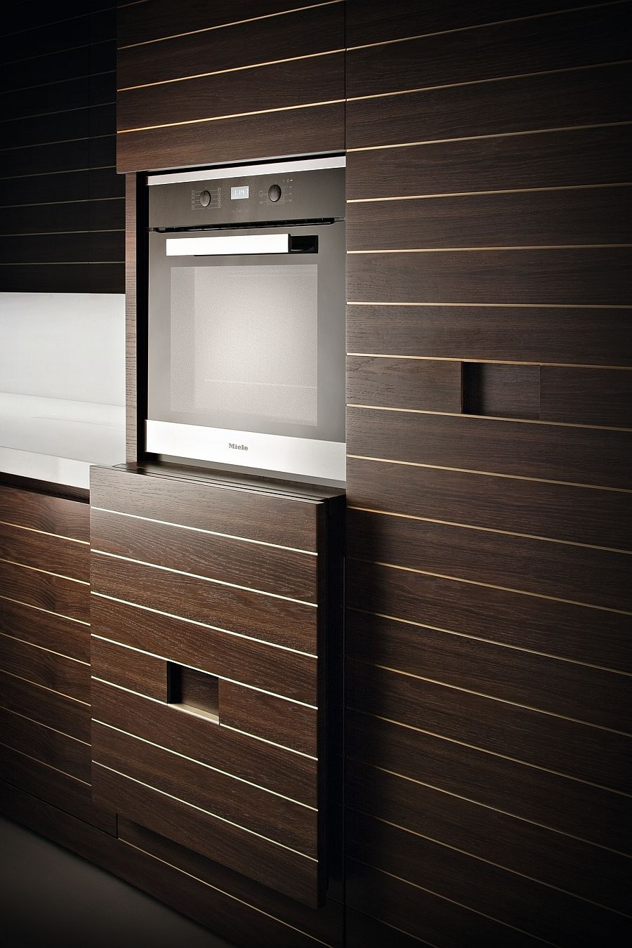 Vertical sliding door to hide the built in appliance