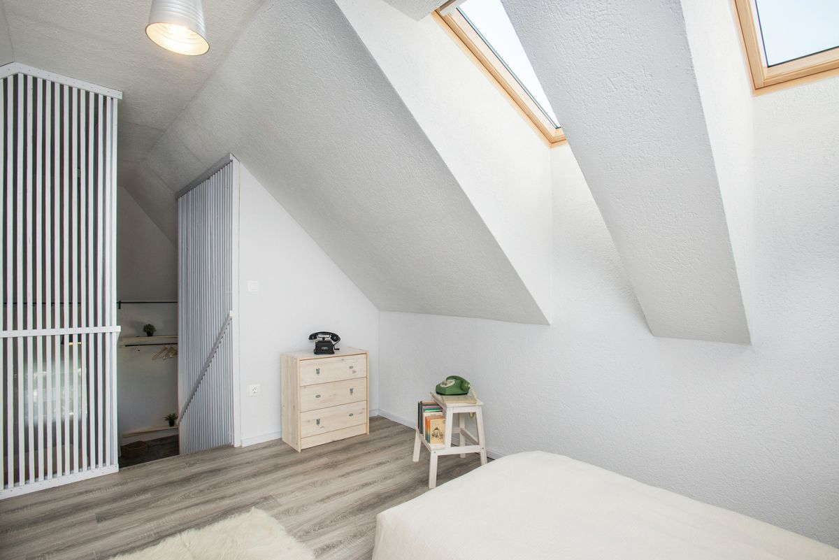angled windows in the attic bedroom