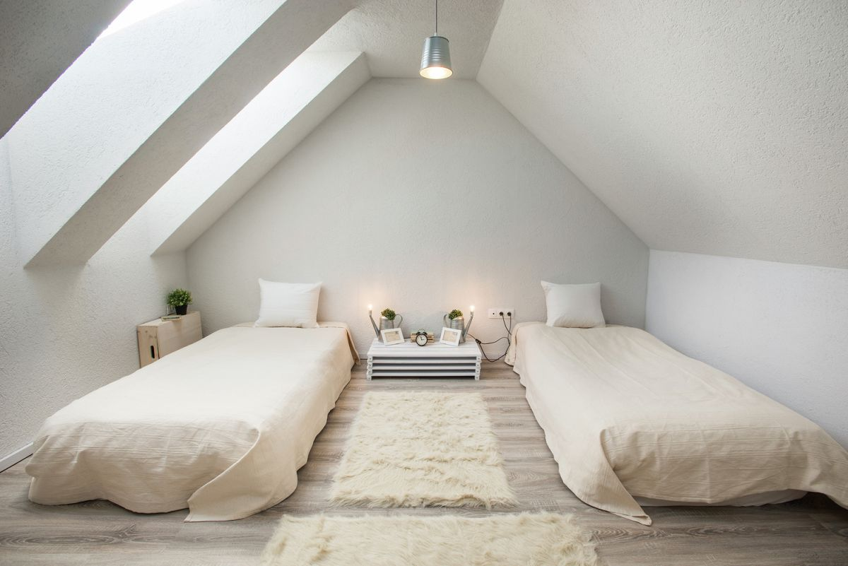 cozy attic bedroom with two single beds