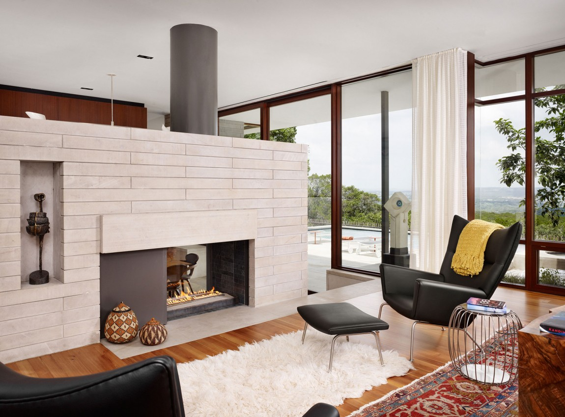 lake view residence seating area with fireplace