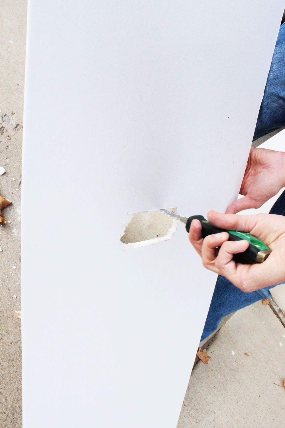 A drywall knife is the easiest tool