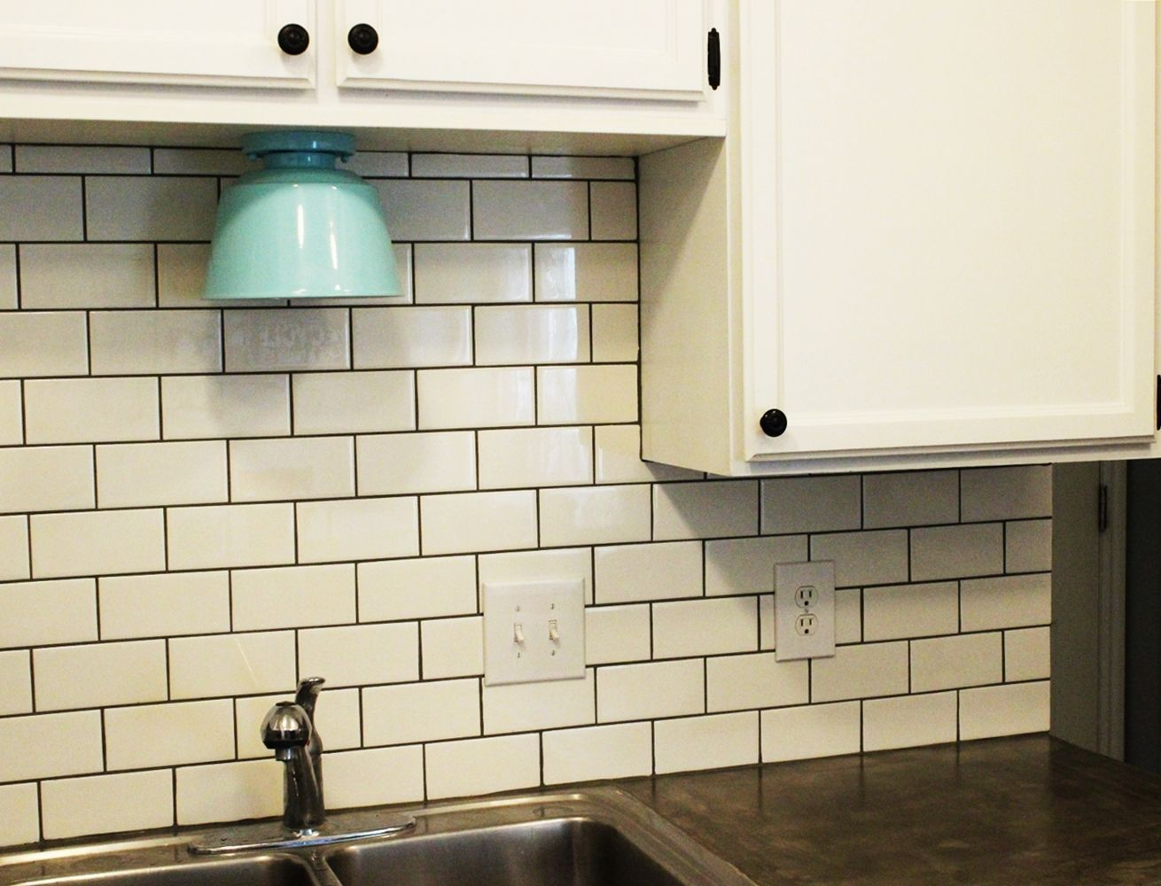 Beautiful kitchen backsplash with tiles and turquoise lighting fixture