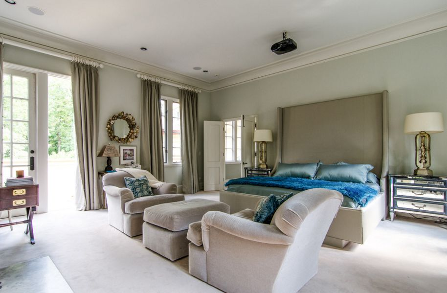 Bedroom featuring a high bed headboard and mirrored nightstands