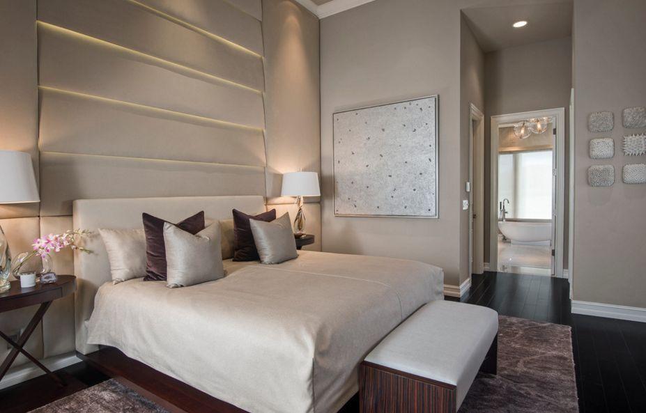 Black hardwood bedroom floor and modern headboard with lights