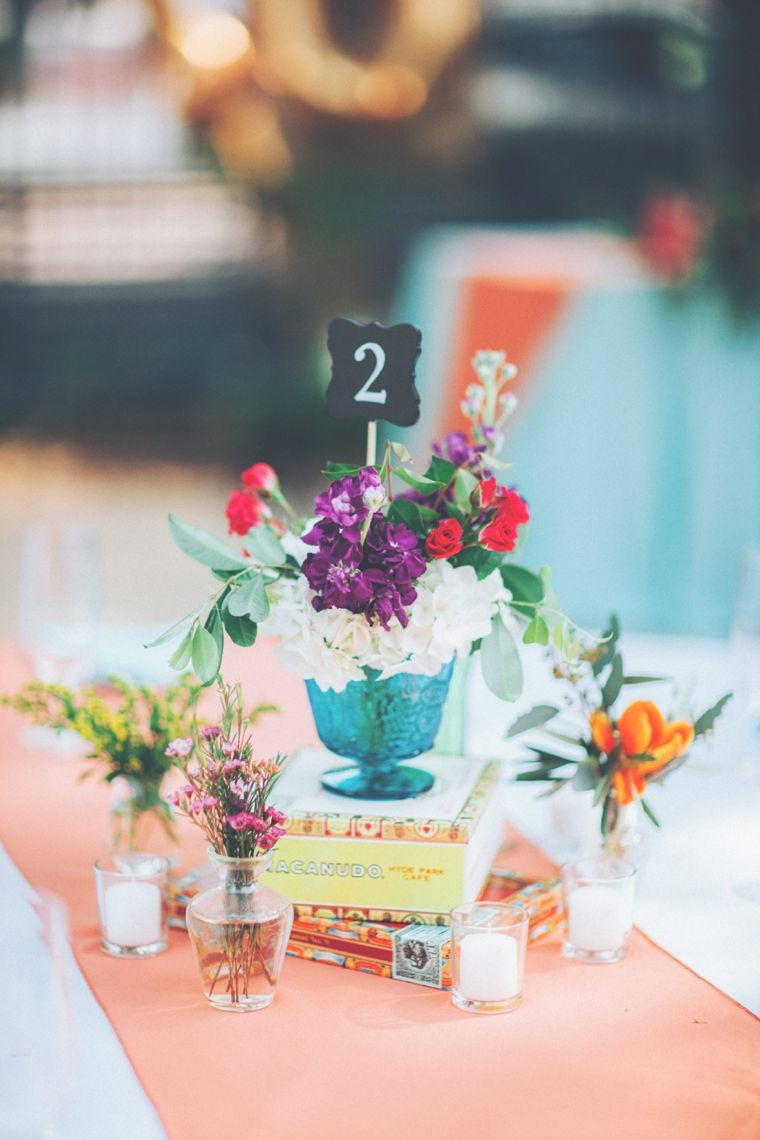 Colorful wedding table centerpiece with number