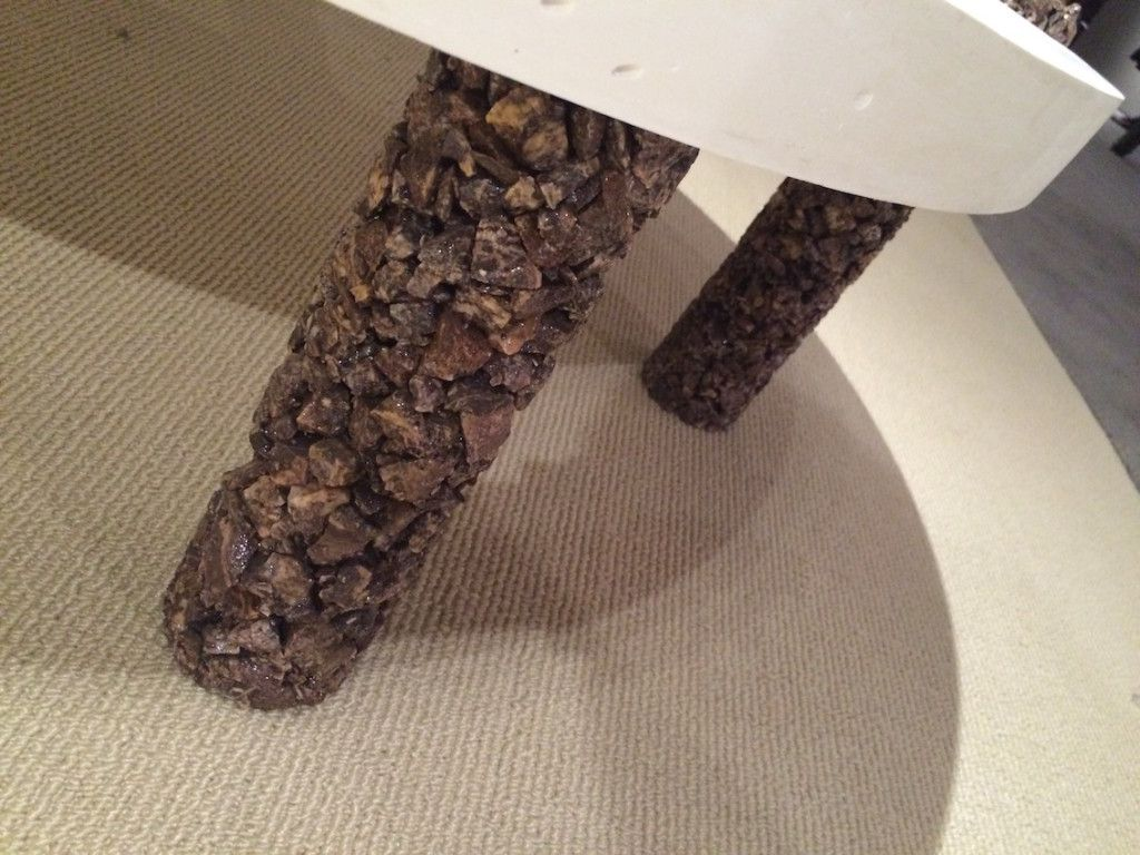 The stone coating give the coffee table legs added interest and heft.