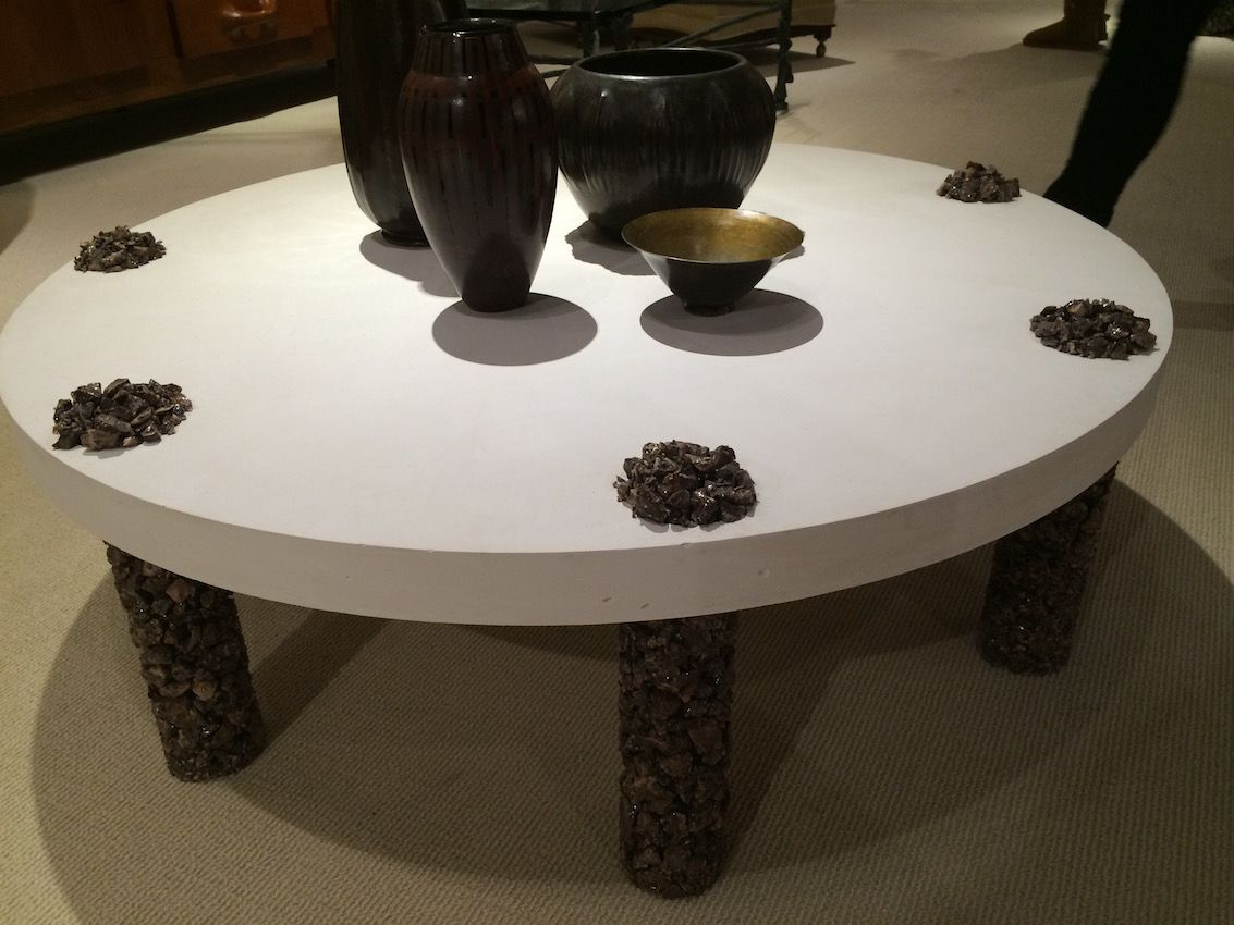 This coffee table features crushed stone on the legs, as well as on top, as a decorative element.