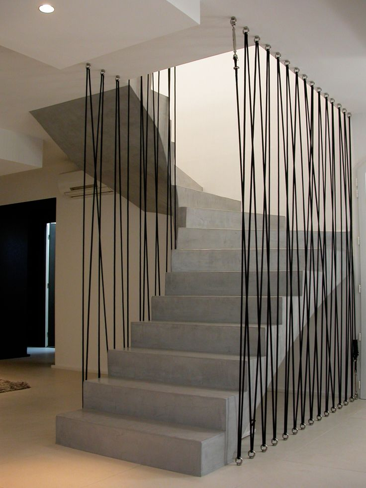 Decorative staircase guard with cords