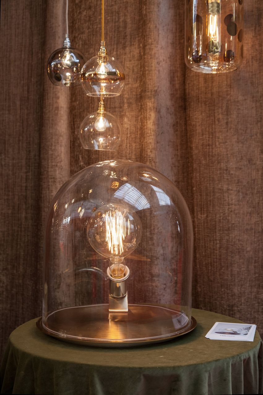 Here, the cloche table lamp is pared with Ebb & Flow's Rowan, which is a beautiful example of modern pendant lighting.