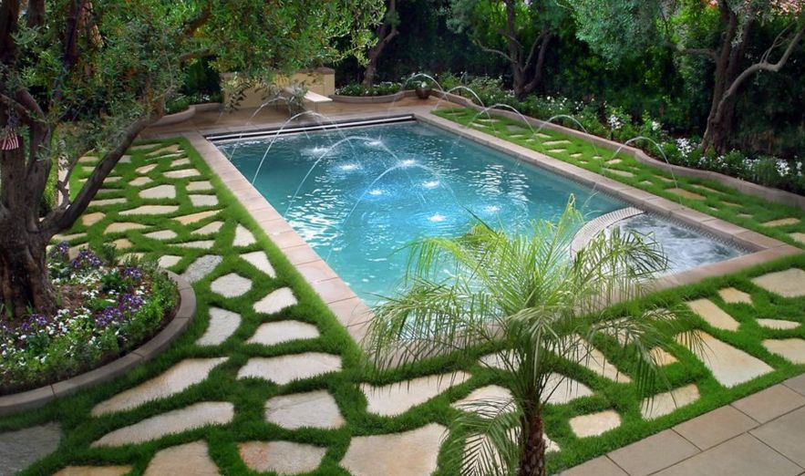 Use flagstone around the pool and highlight the geometry with grass
