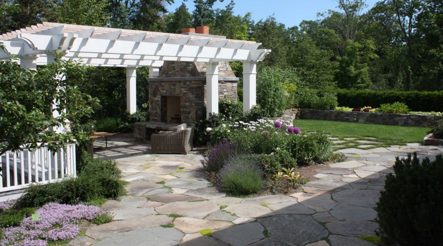 A Flagstone Patio Can Include Flower Beds Or Be Installed Around The Existing Trees