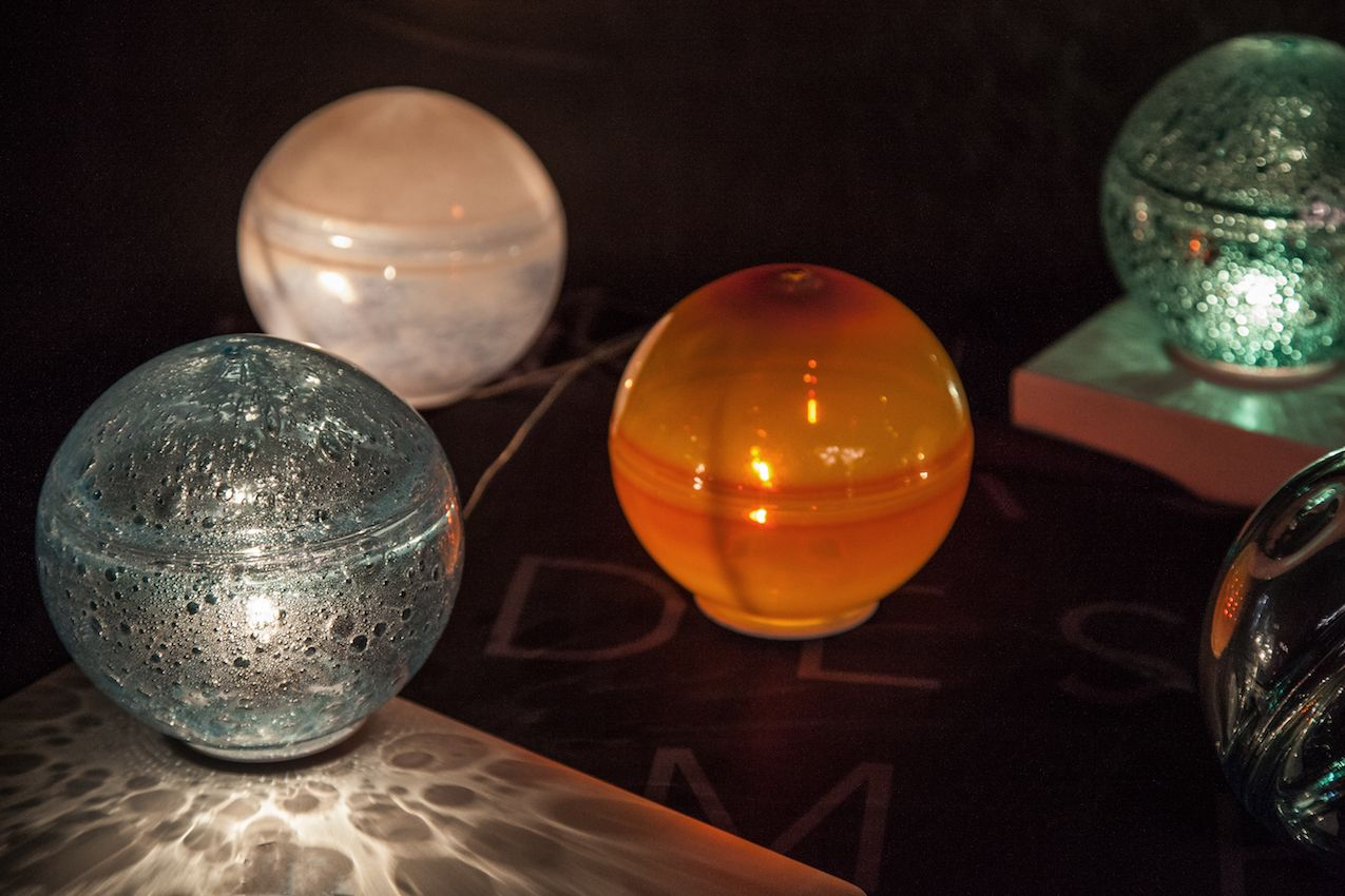 The natural imperfections in these glass globes enhance the design of the light emitted.