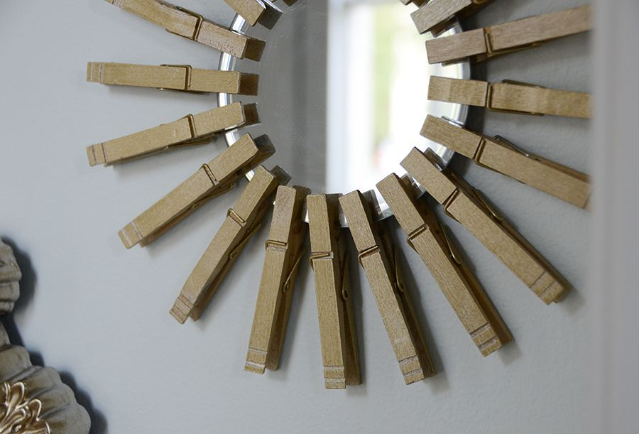 Gold Starburst Mirror With Clothespins