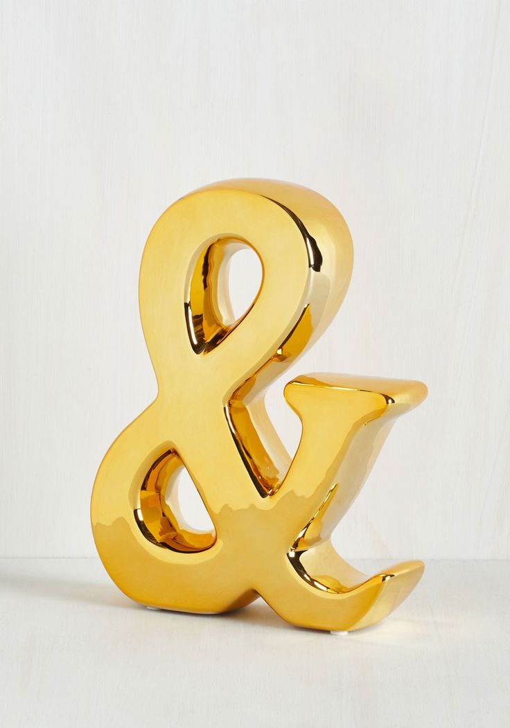 Gold ampersand figurine