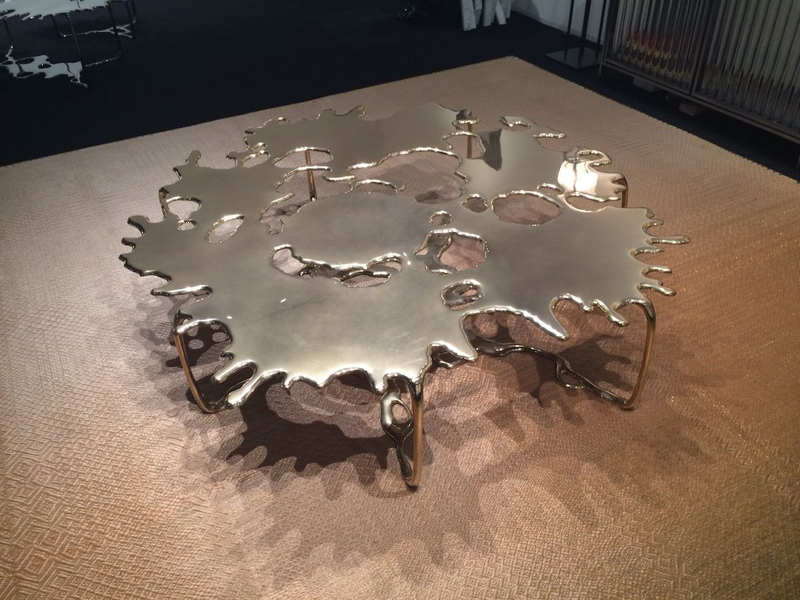 Created in bronze, this coffee table would be the focal point in any interior design.
