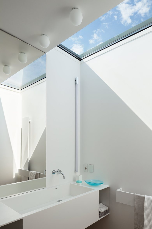 House C by Zaetta Studio bathroom skylight