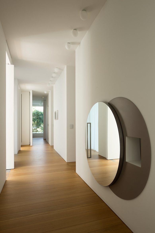 House C by Zaetta Studio hallway mirror reveals secret nook