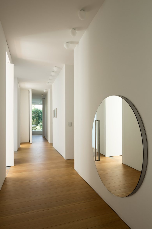 House C by Zaetta Studio hallway mirror