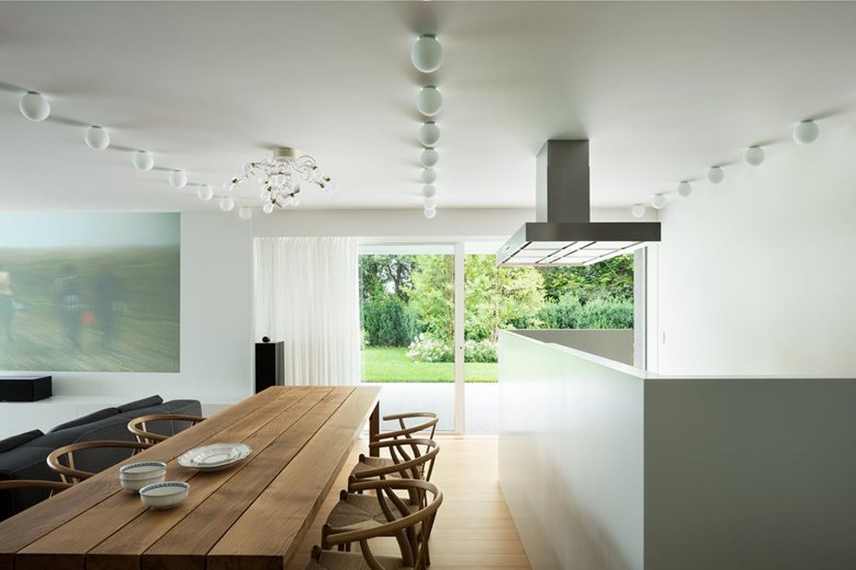 House C by Zaetta Studio kitchen island and dining table