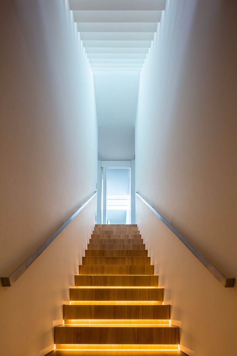 House C by Zaetta Studio staircase accent lights
