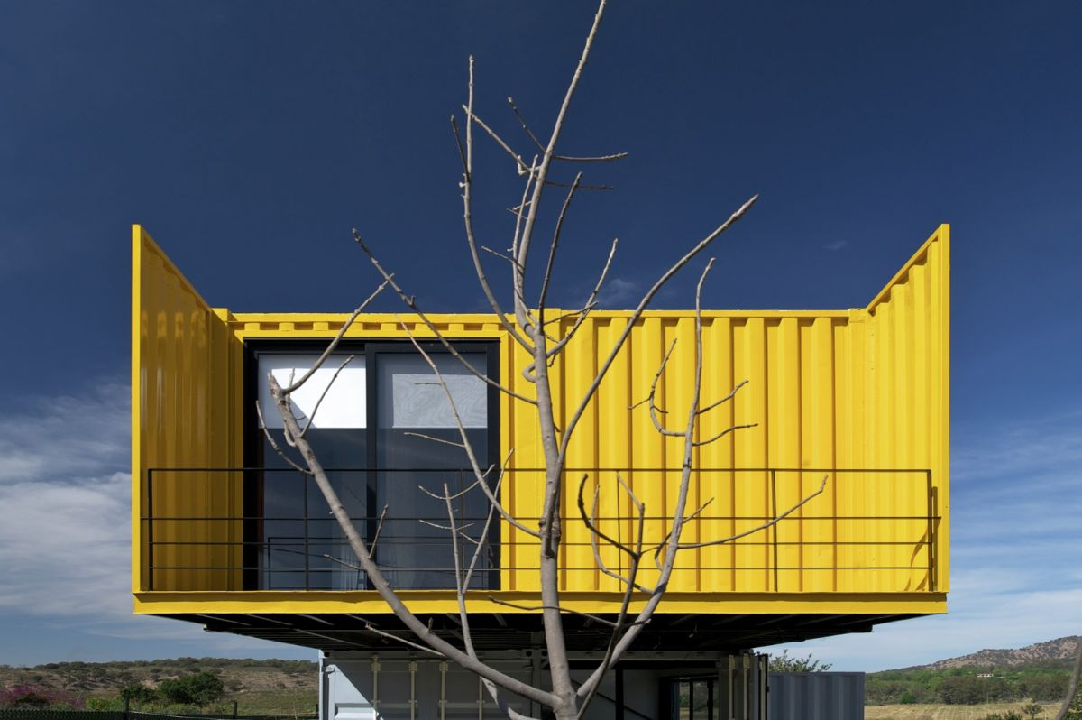 Huiini House by S+diseno upper floor yellow exterior