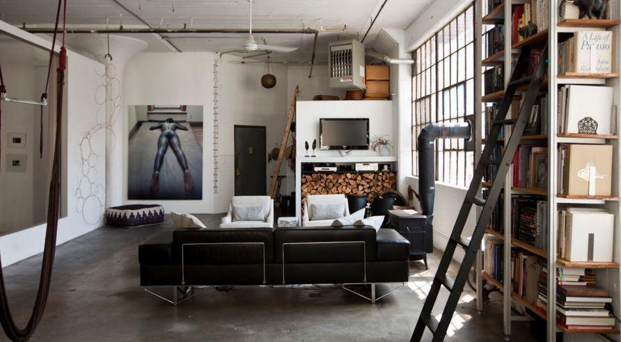 Industrial Loft Design With A Metalic Bookshelf