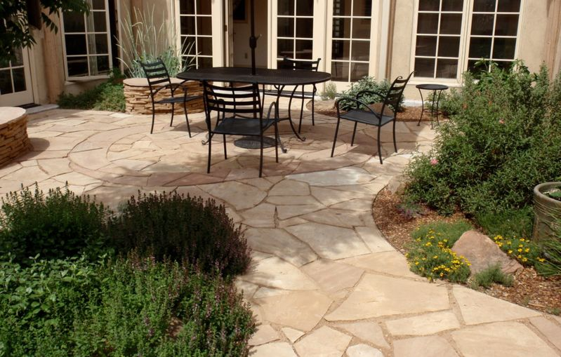 The irregular and unique shape of each flagstone makes this a great choice for organic-shaped patios [ From WaterWise Landscapes Incorporated ]