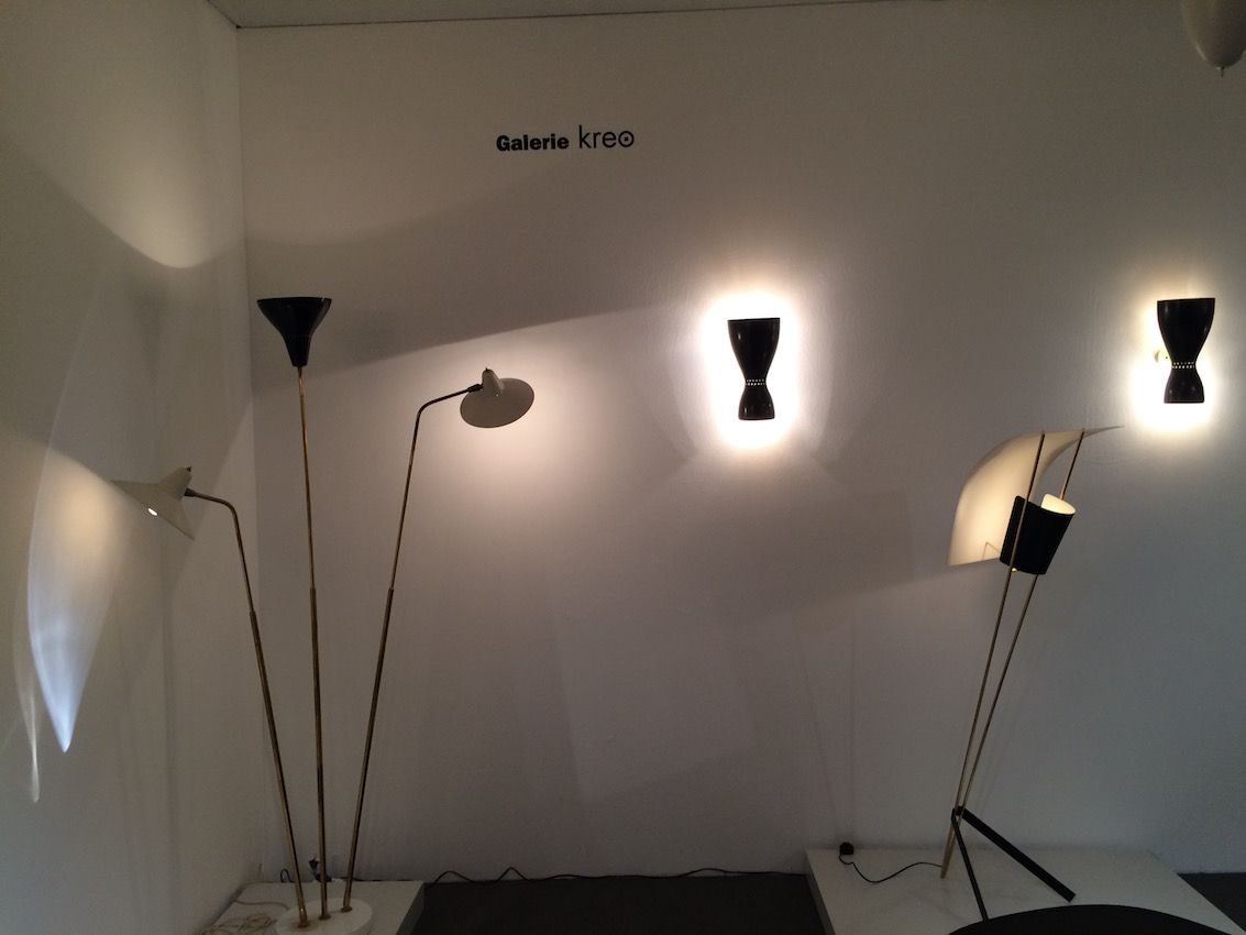 A variety of floor lamps illuminate one section of the display area.