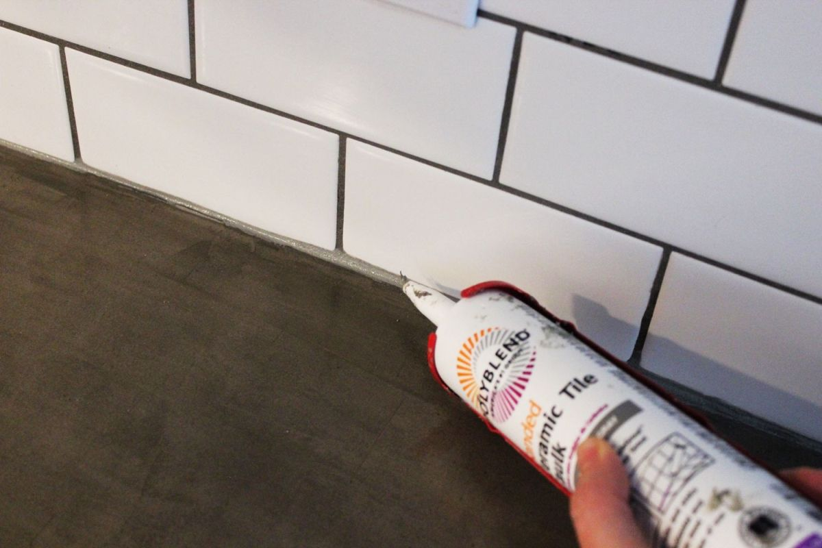 Lay a thin strip of caulk along