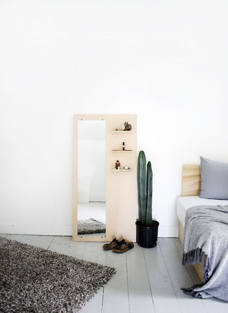 Leaning mirror with shelf