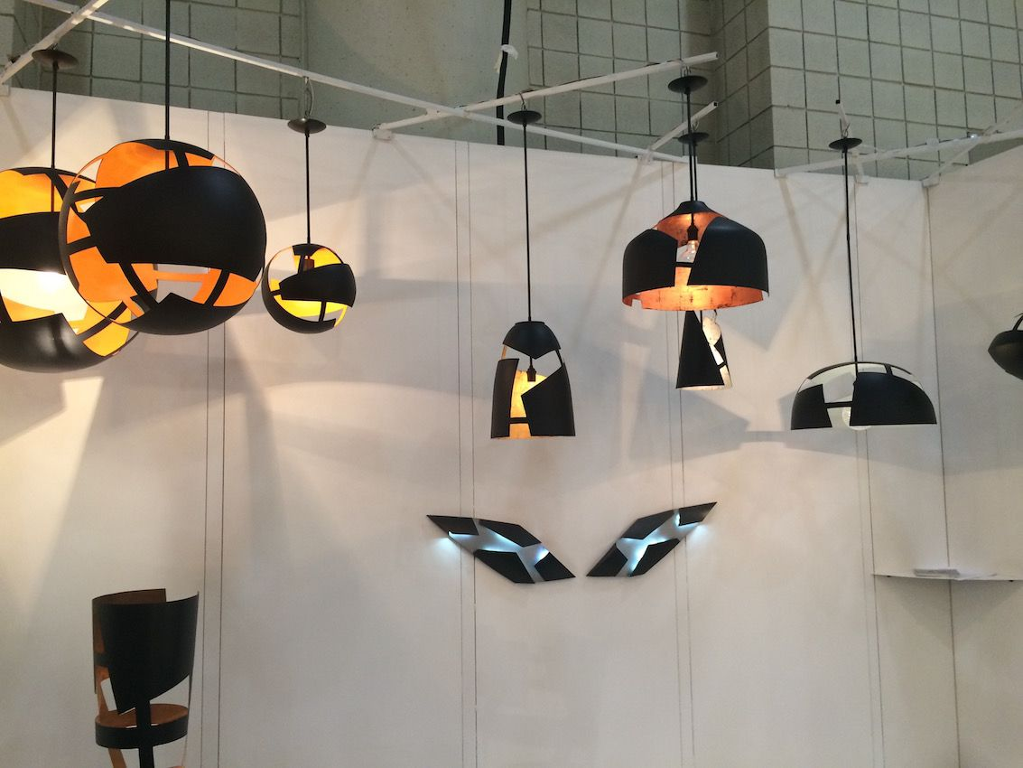 The range of colors use in the interior of these fixtures enlivens the black coated exteriors.