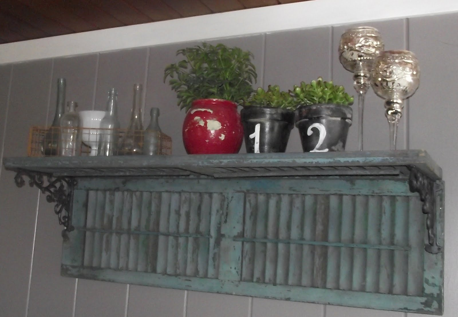 Old window shutters turned into shelves