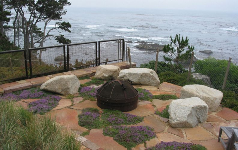 For a more organic and natural look, decorate the patio with large stones and patches of moss