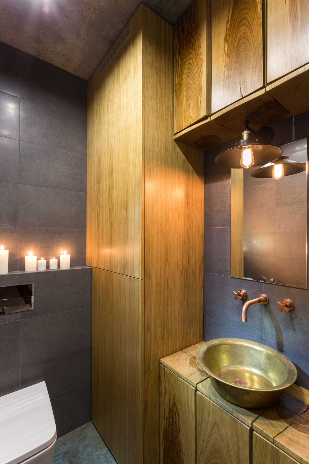 Remodeled Kiev apartment bathroom wood cabinetry