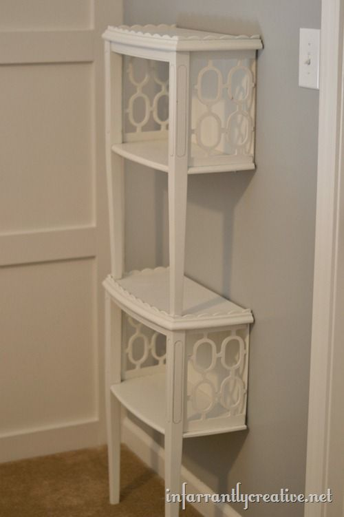 Stacked end tables turned into shelves