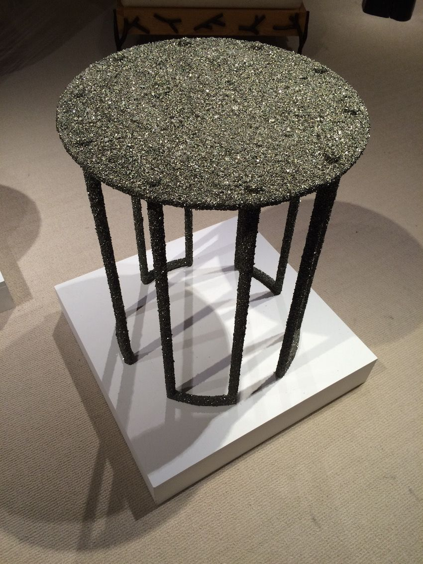 Crush pyrite adorns this small table as well, creating a glittering piece that would work in a casual or formal environment.