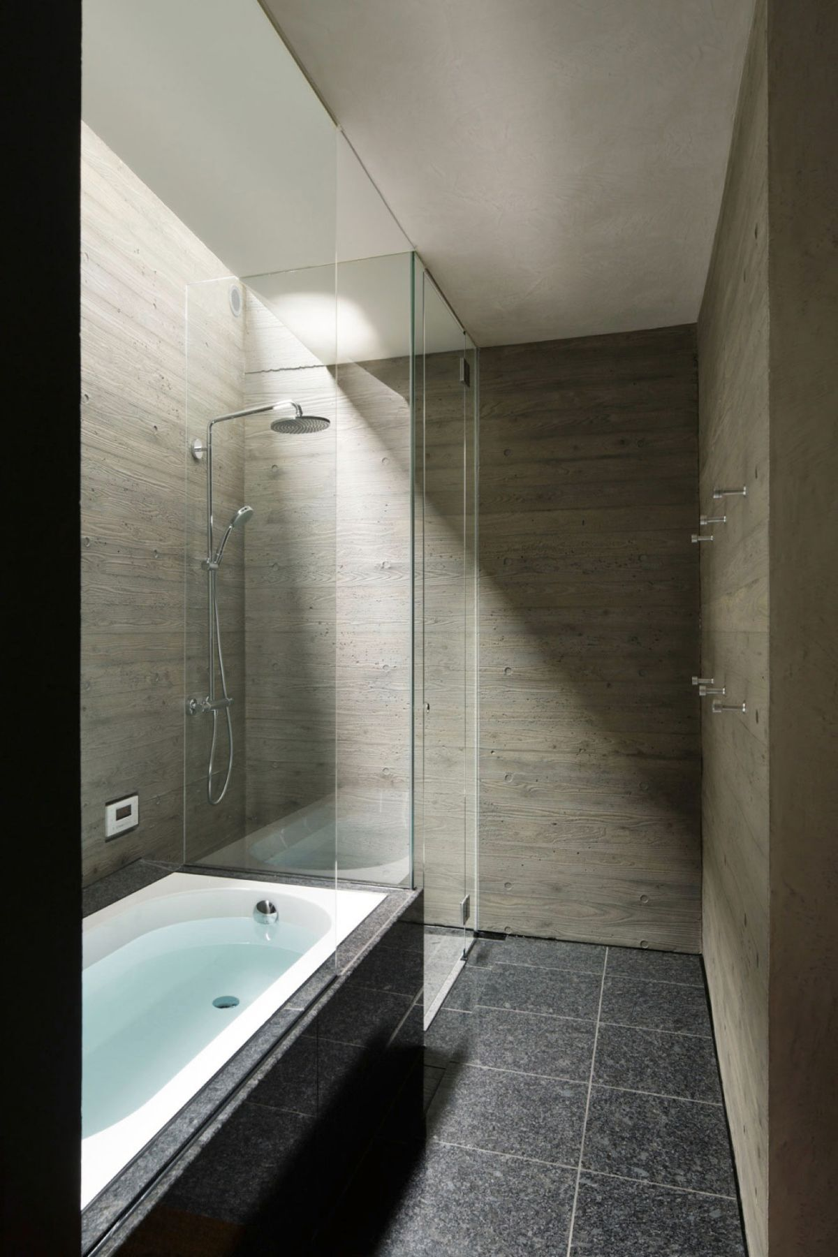 The SRK residence in Tokyo features a glass walk-in shower