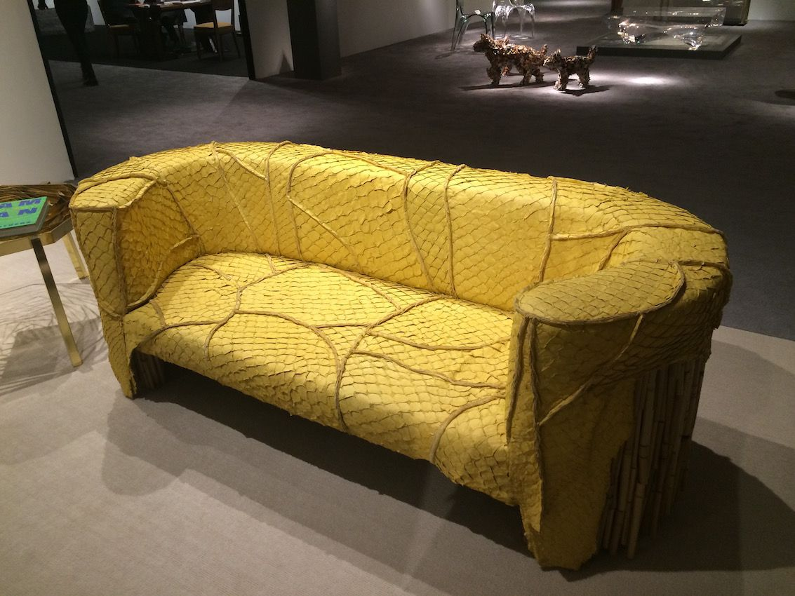 The skins of the Pirarucu -- also called an arapaima -- are applied to the seating by French artisans.