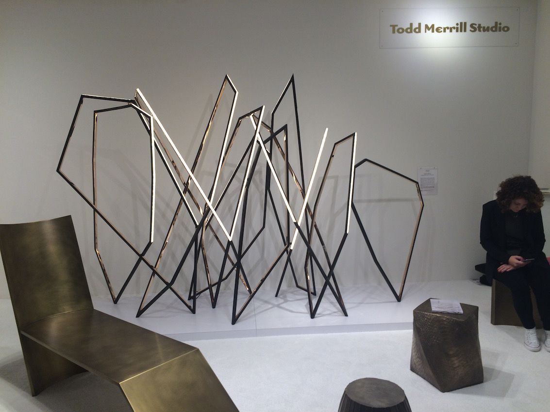 "The focal point of the booth was Niamh Berry's light sculpture, ""Walking."" The Irish artist creates fine light sculptures and furniture, from a variety of materials."