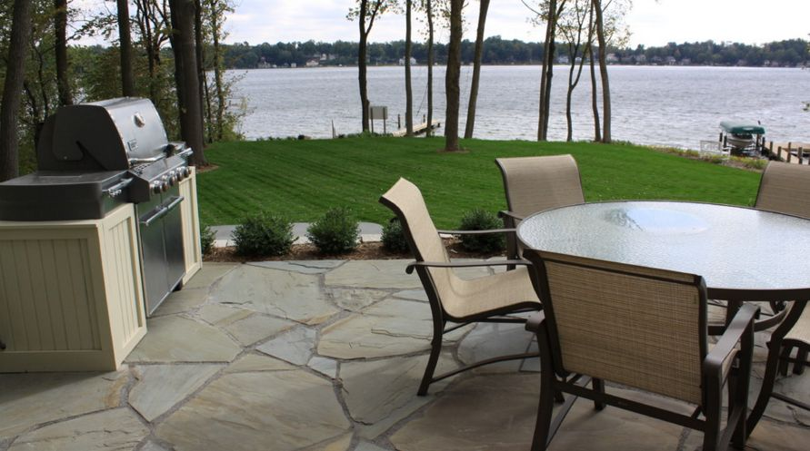 Flagstone also works wonderfully for traditional patios, regardless of the surroundings [Design from Arcadia gardens LLC ]