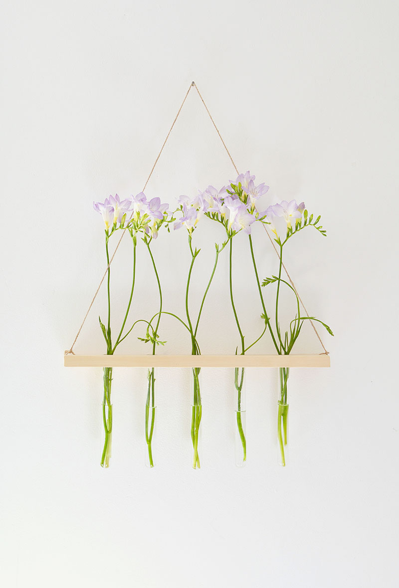Tube vases display flowers