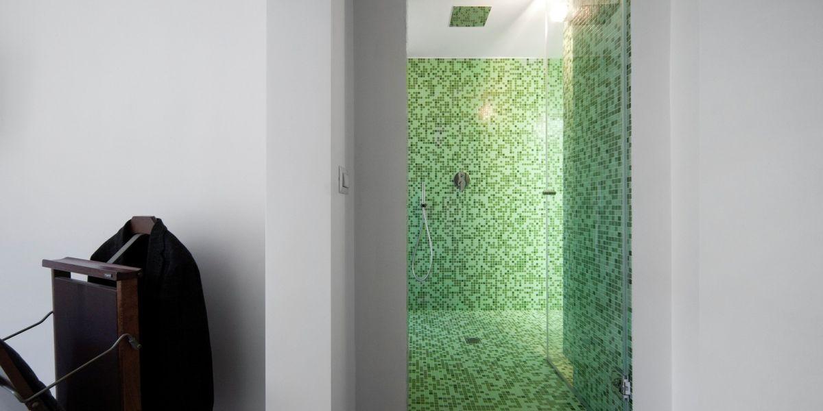 Turin apartment renovation bathroom green mosaic