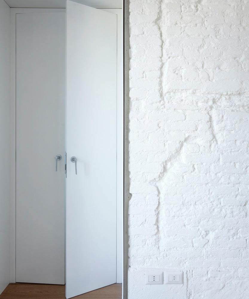 Turin apartment renovation brick wall closeup